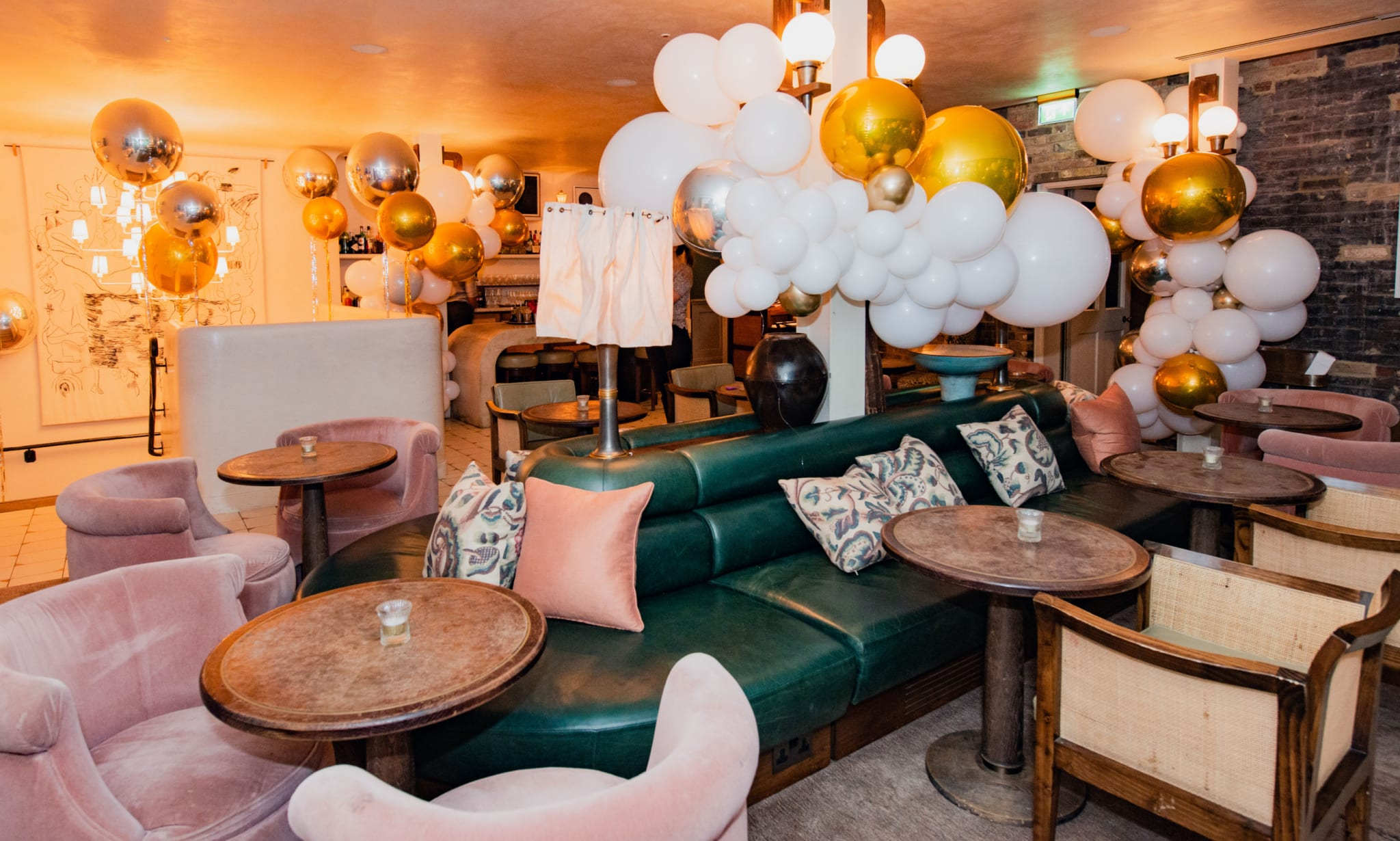 A lounge-like interior full of balloons.