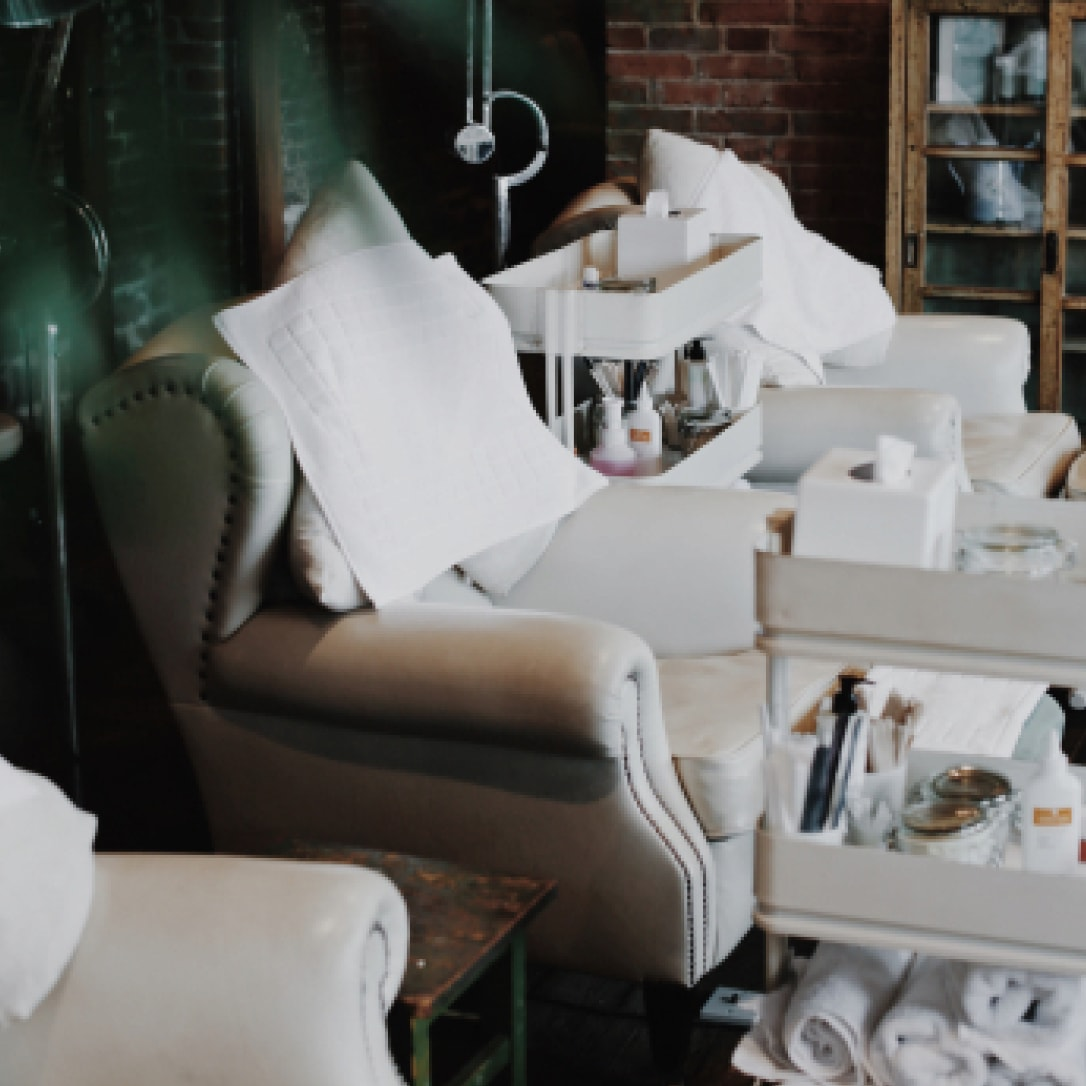 White armchairs in a spa interior.