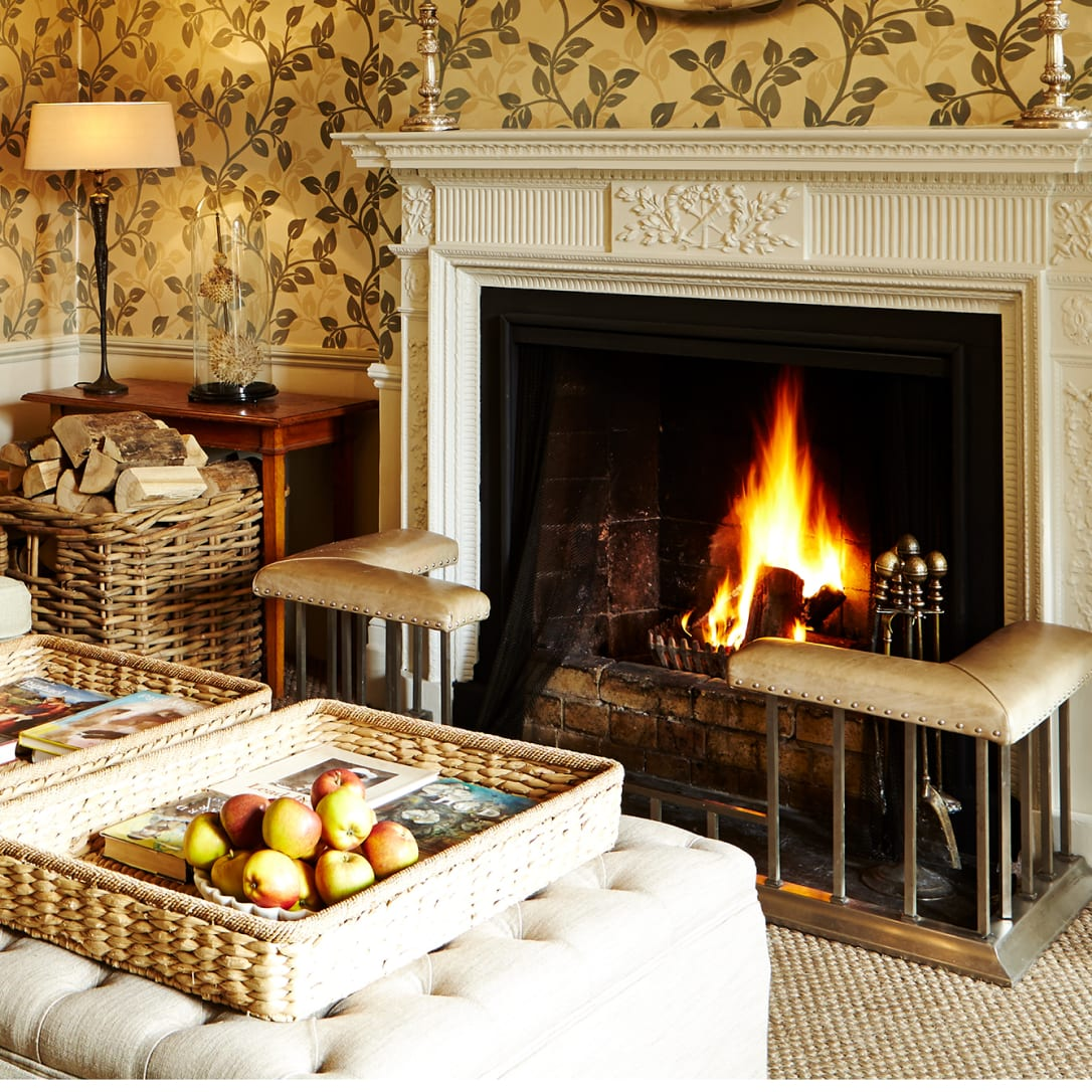 A log fire burning in a fireplace.