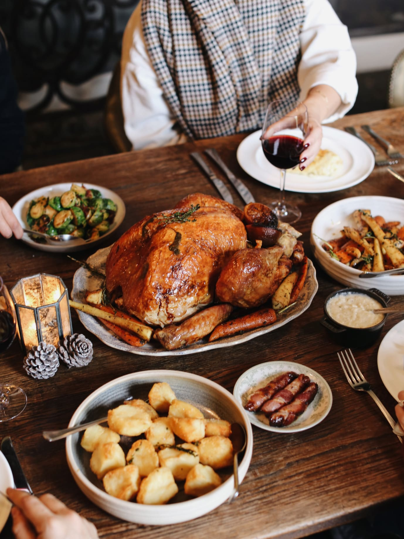 A sunday roast dinner including a giant roast turkey.