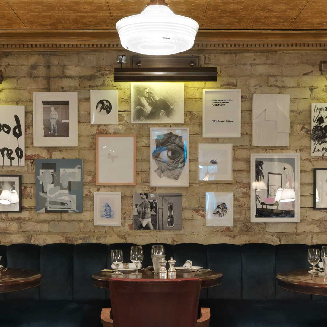 A restaurant with various artworks on the walls.