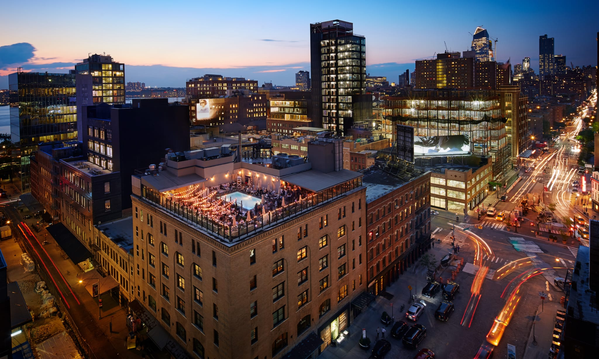 Aerial view of rooftop of a building in New York at night.