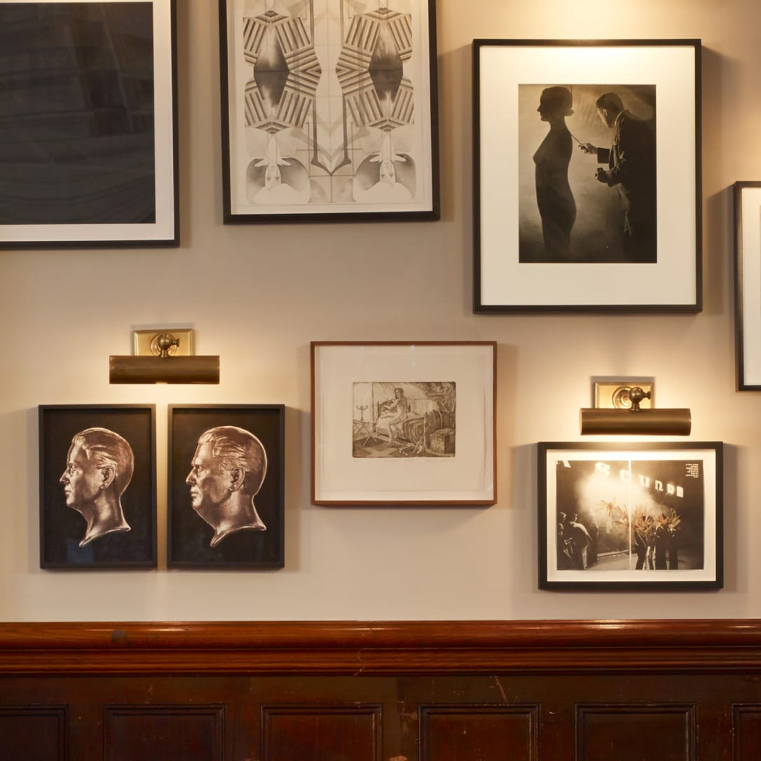 A selection of artworks hanging on a wall.