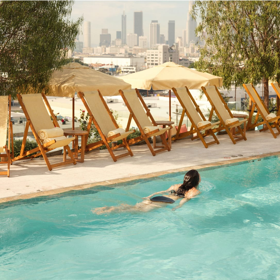 A woman swims in a rooftop pool