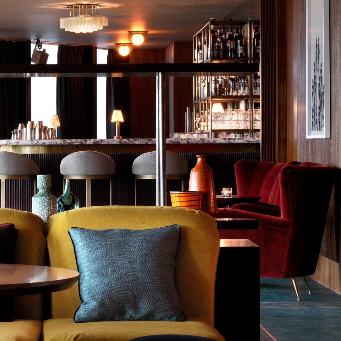 A lounge like space with a bar.