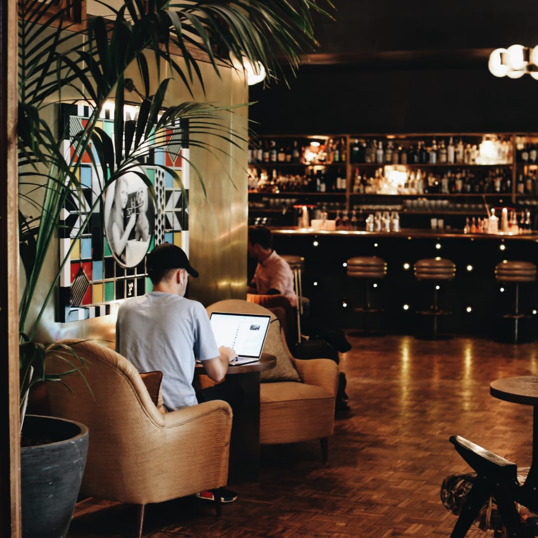 People working in a bar interior.