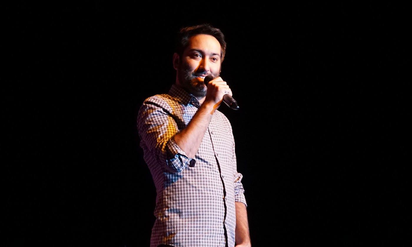 man on mic on stage