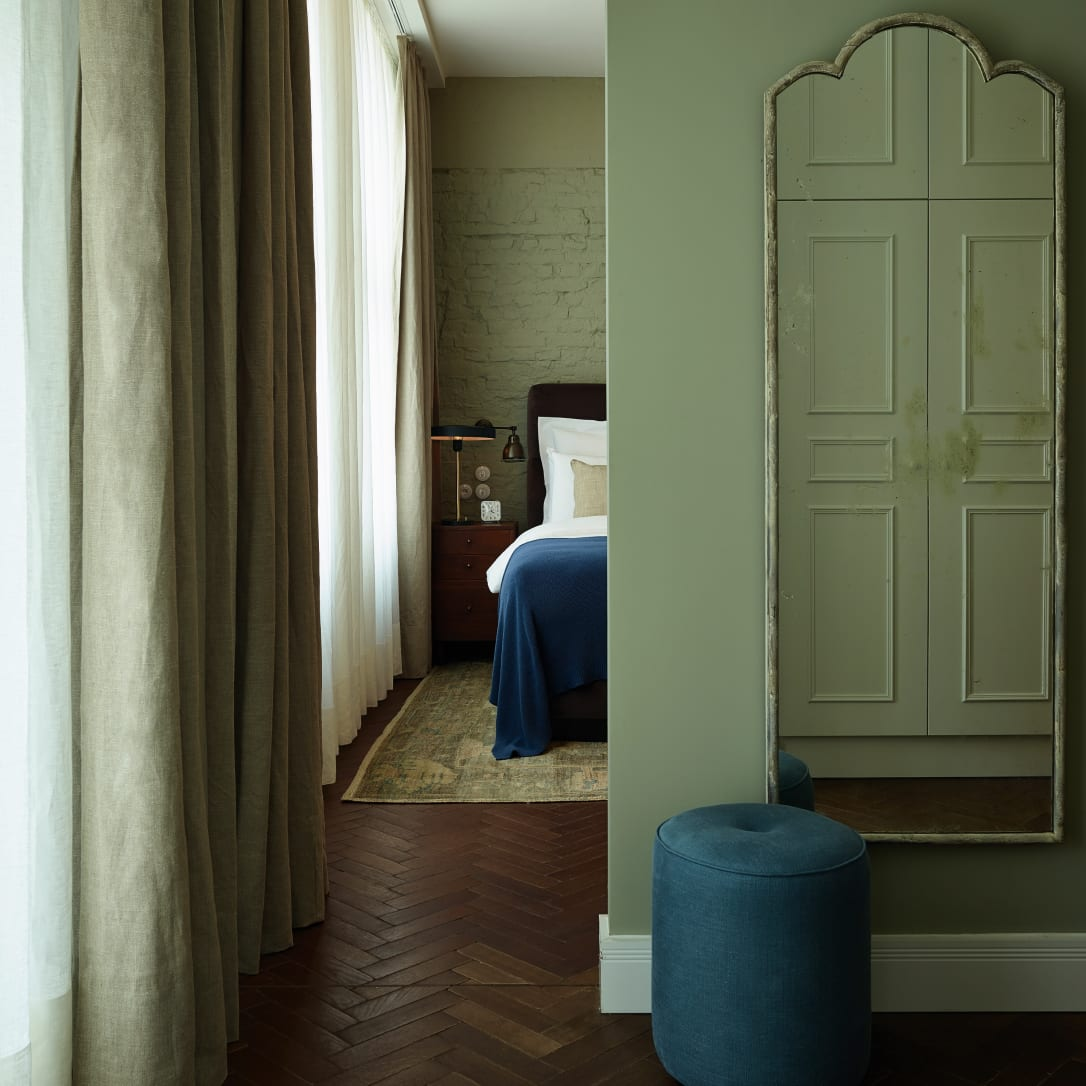 A passageway leading through to a bedroom.