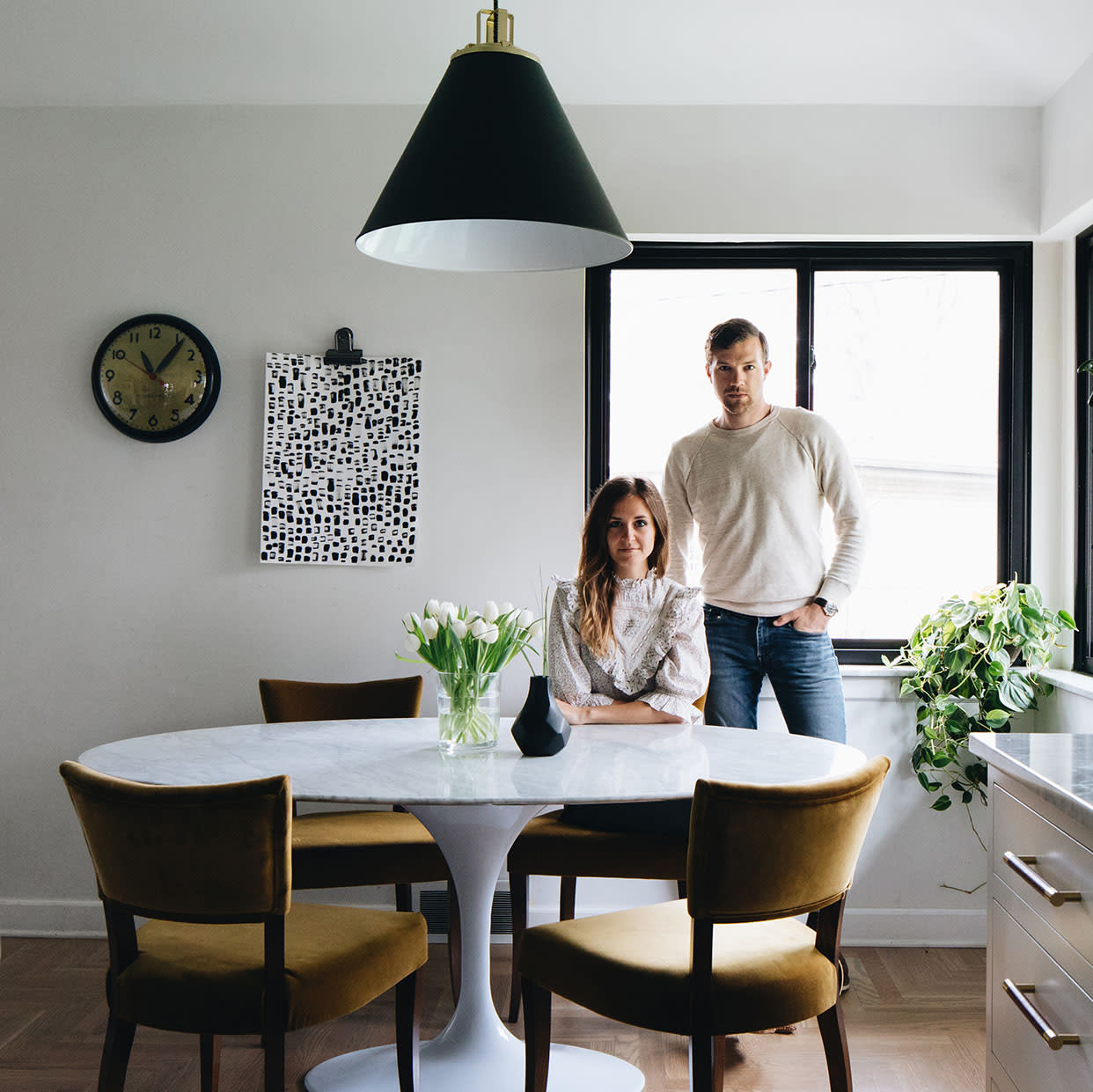 man and woman at kitchen table
