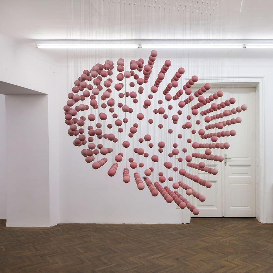 suspended sculpture in gallery