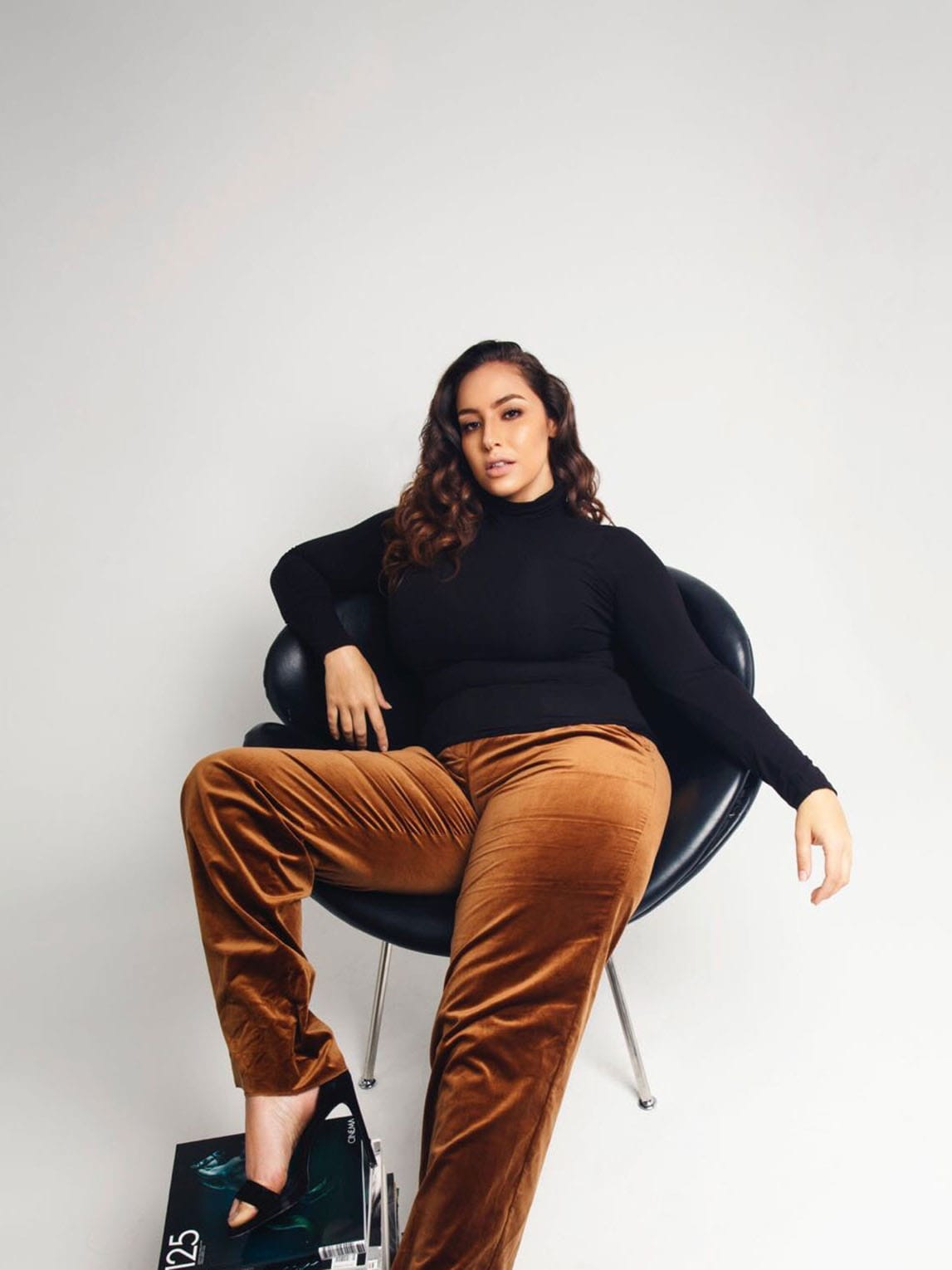 Woman posing relaxed in chair
