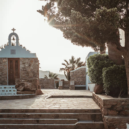 a chapel and sunny path on greek island
