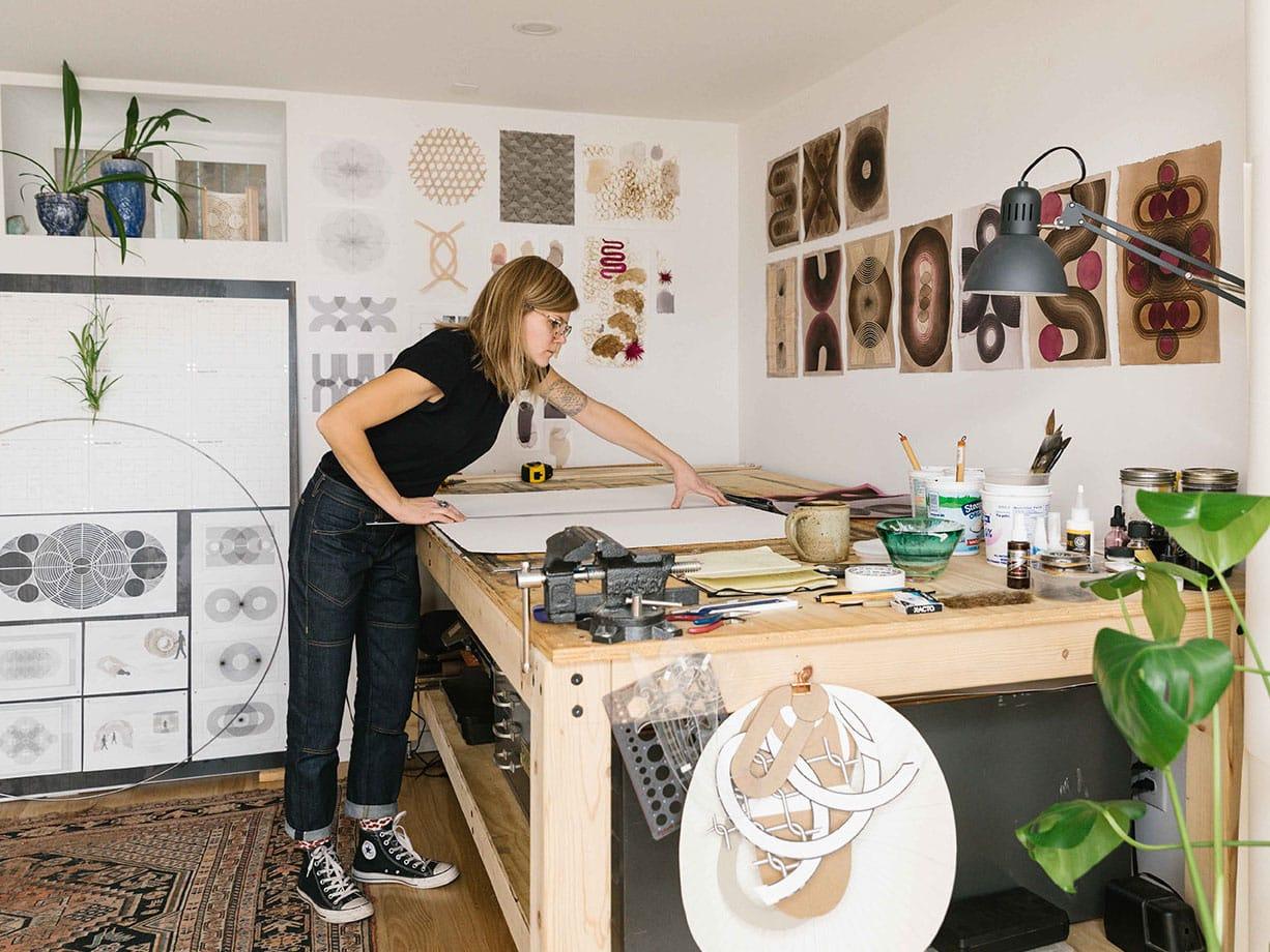 a woman making art in a studio