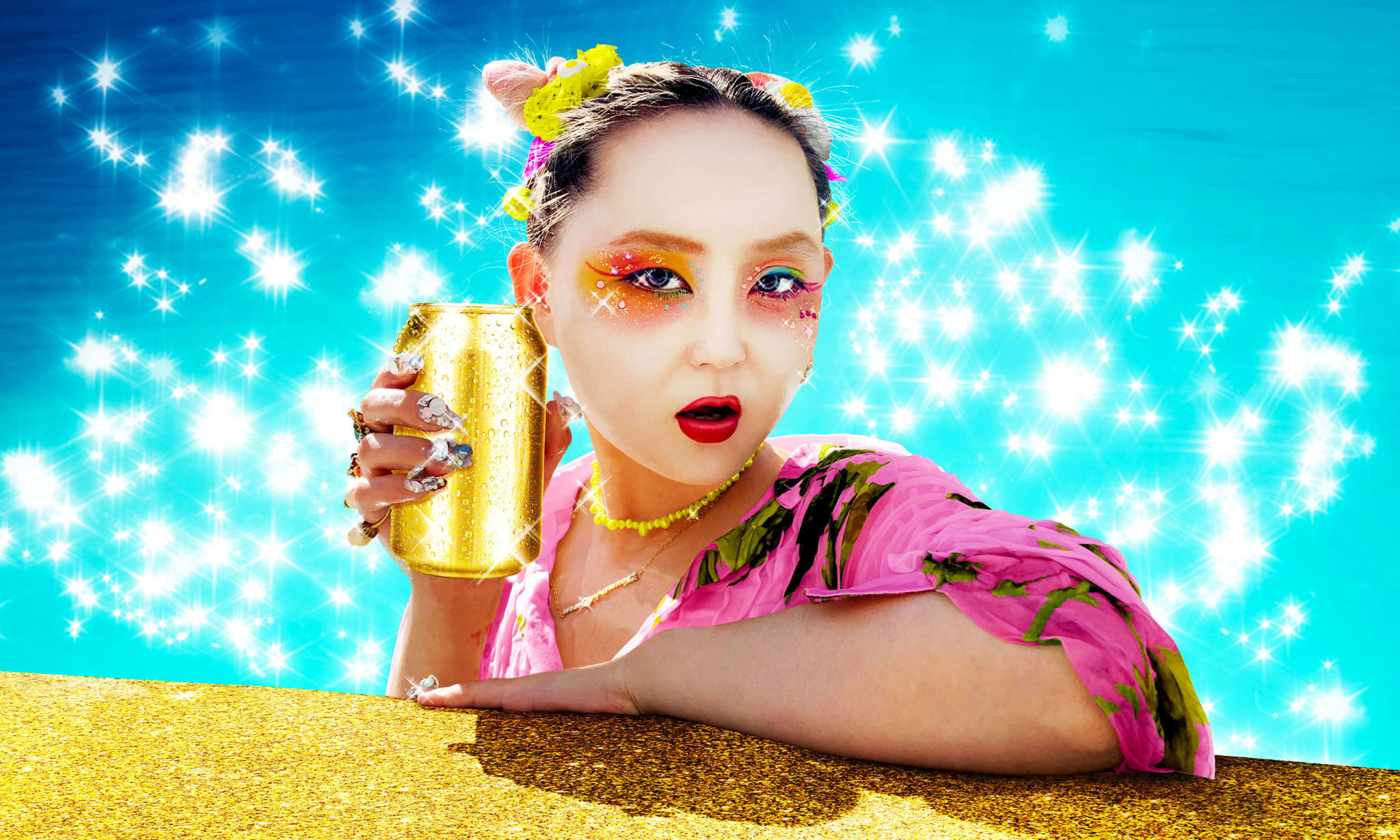 A girl in geisha make-up holding a golden drinks can.