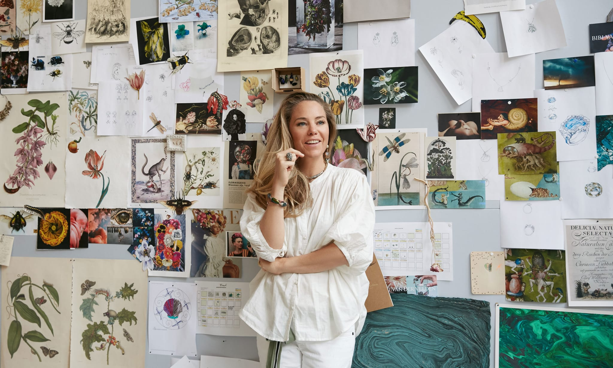A woman standing in front of a mood board.