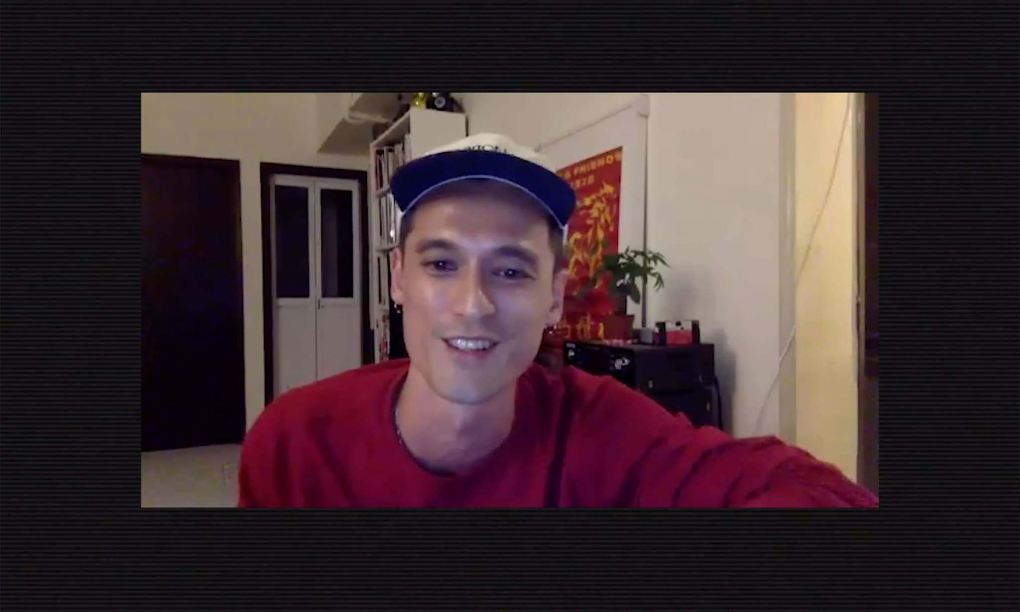 A man smiling during a video call.