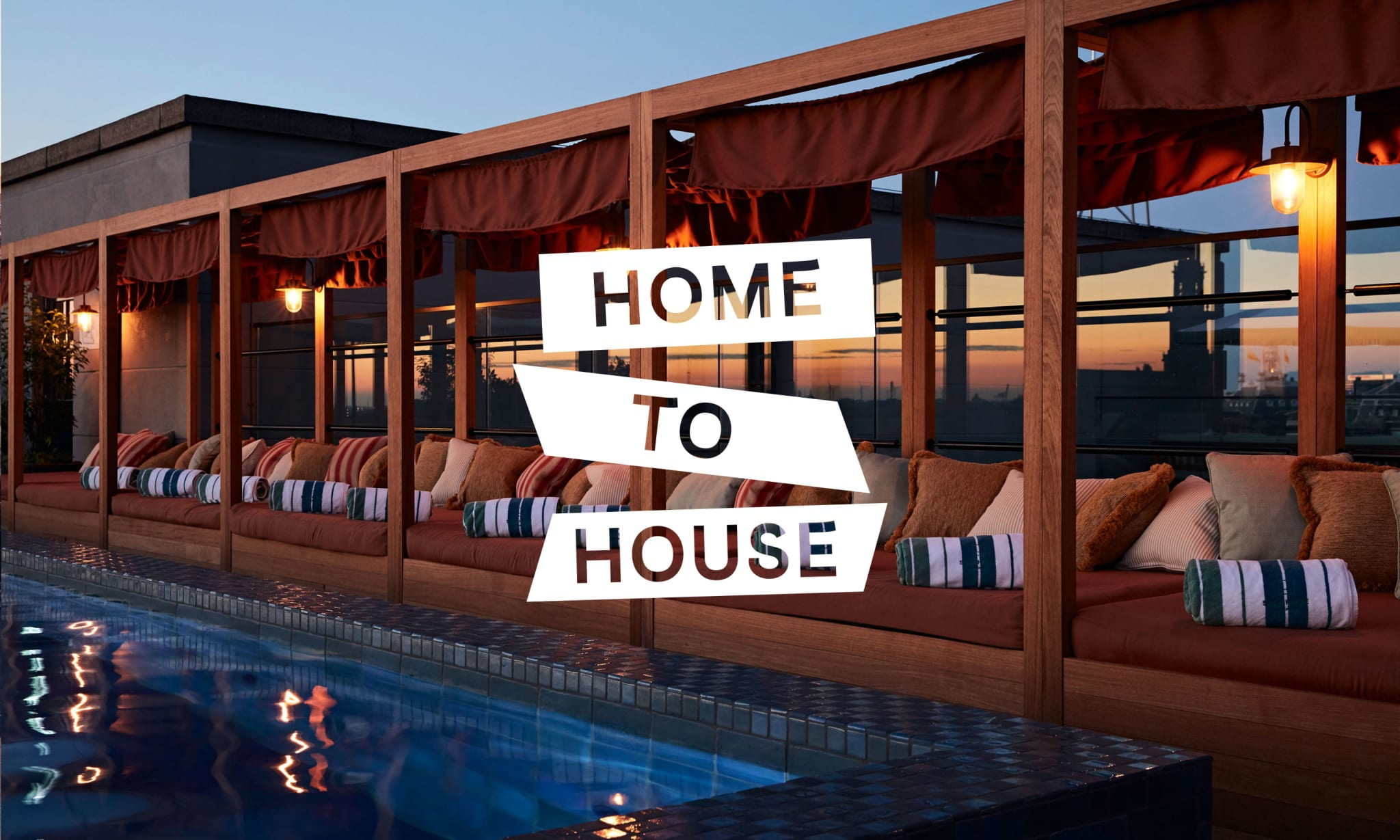 A rooftop pool and day beds at sunset with a Home To House logo on top of it.