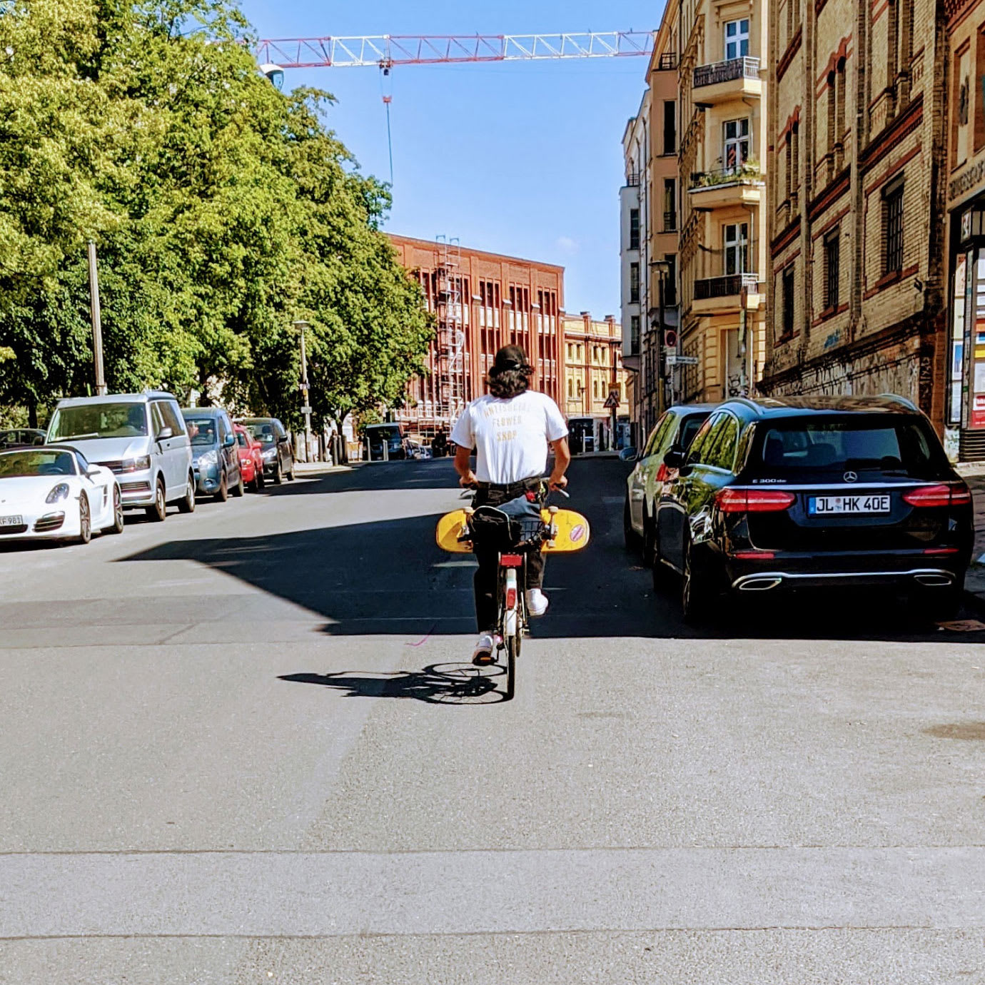 A person cycling down a city street.