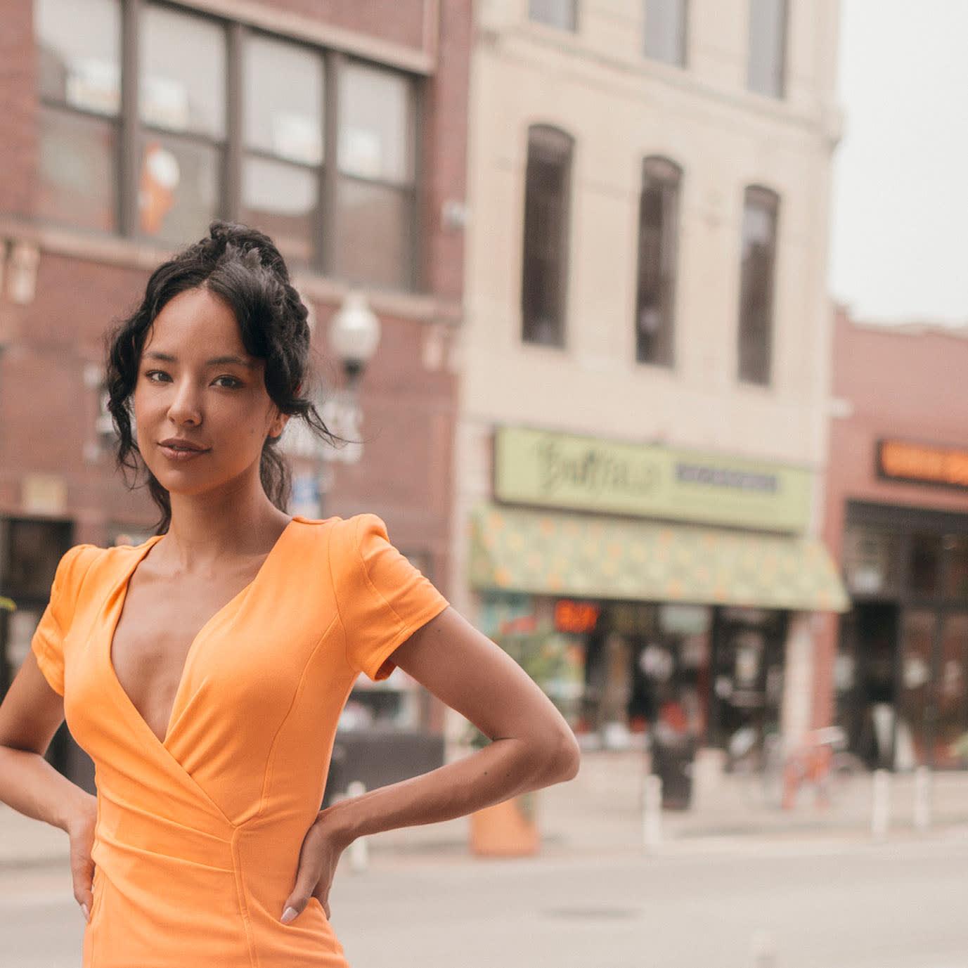 woman in orange dress on street