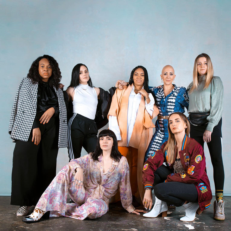 group of women posed in studio