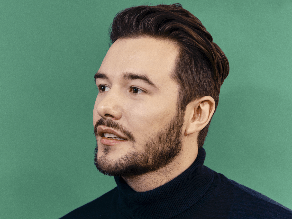 Portrait of man in turtleneck looking into the camera