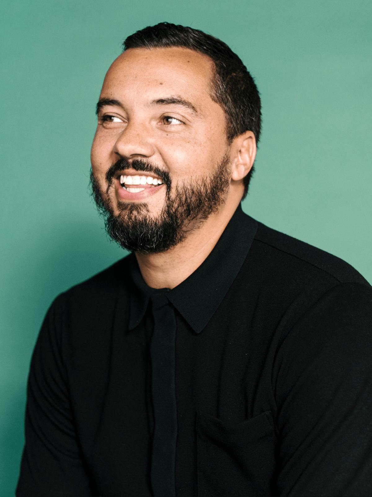 Man in black shirt laughing