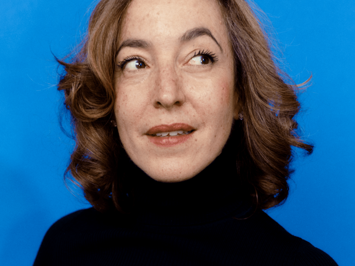 Woman looking sideways smiling