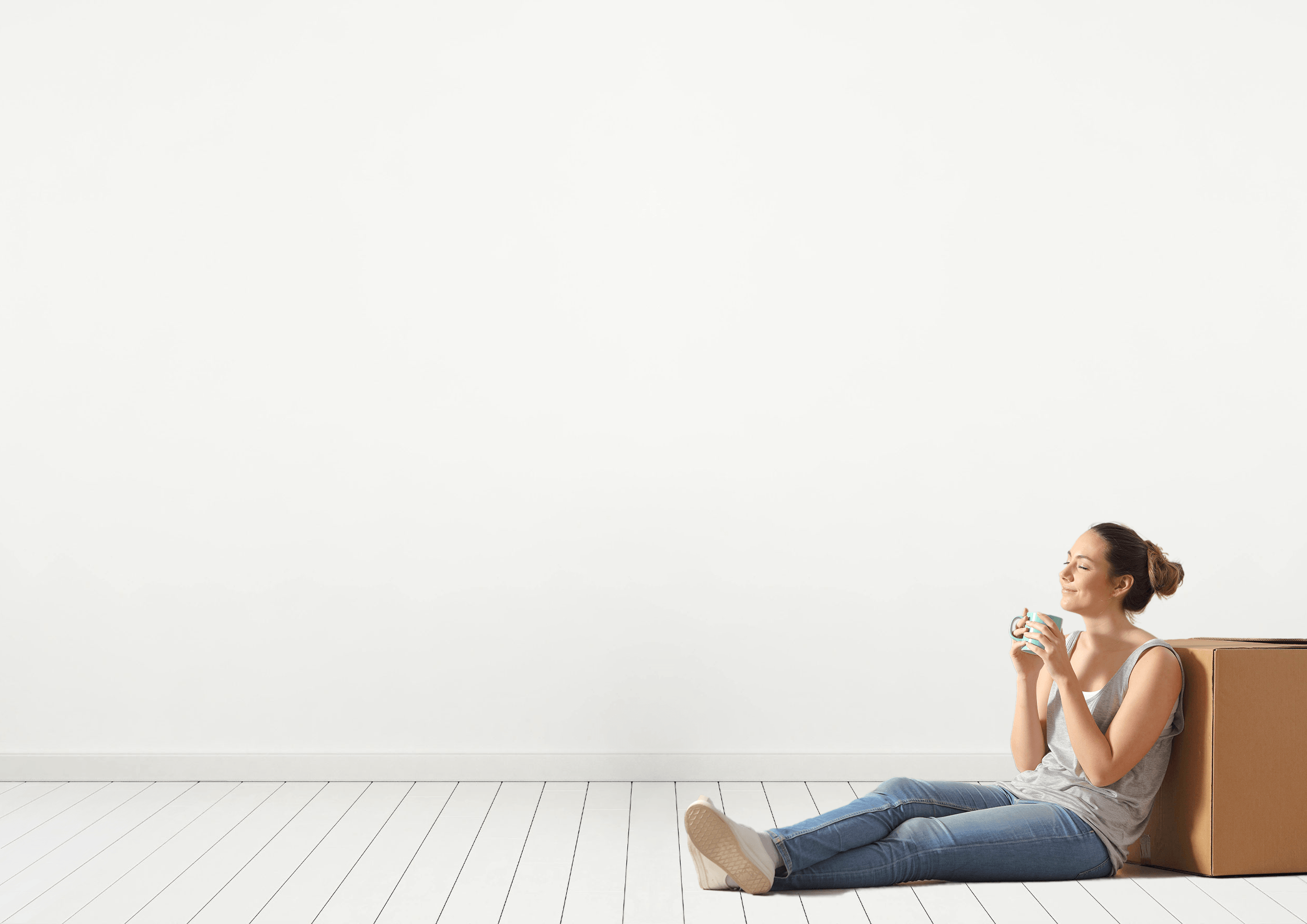 Woman sitting on floor after selling a house with a top SoldNest real estate agent