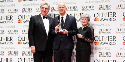 Dominic Cooke, winner of the Olivier Award for Best Revival for Ma Rainey's Bottom, with presenters Julia McKenzie and Jim Carter (Photo: Pamela Raith)