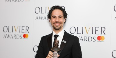 Alex Lacamoire, winner of the Outstanding Achievement in Music award for Hamilton at the Olivier Awards 2018 with Mastercard