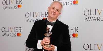 Dominic Cooke, winner of the Magic Radio Best Musical Revival award for Follies at the Olivier Awards 2018 with Mastercard