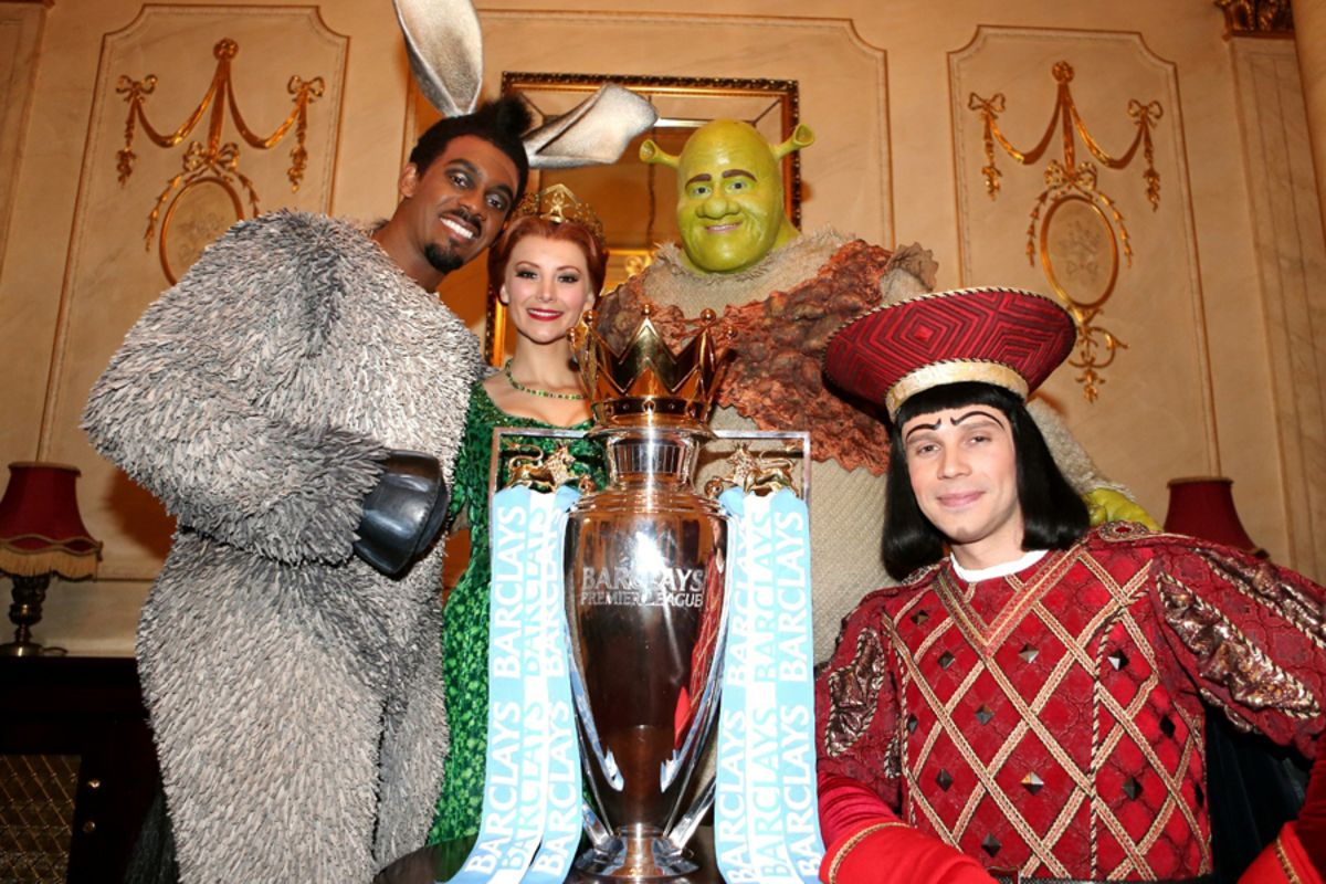 The Shrek The Musical cast pose with the Premier League trophy