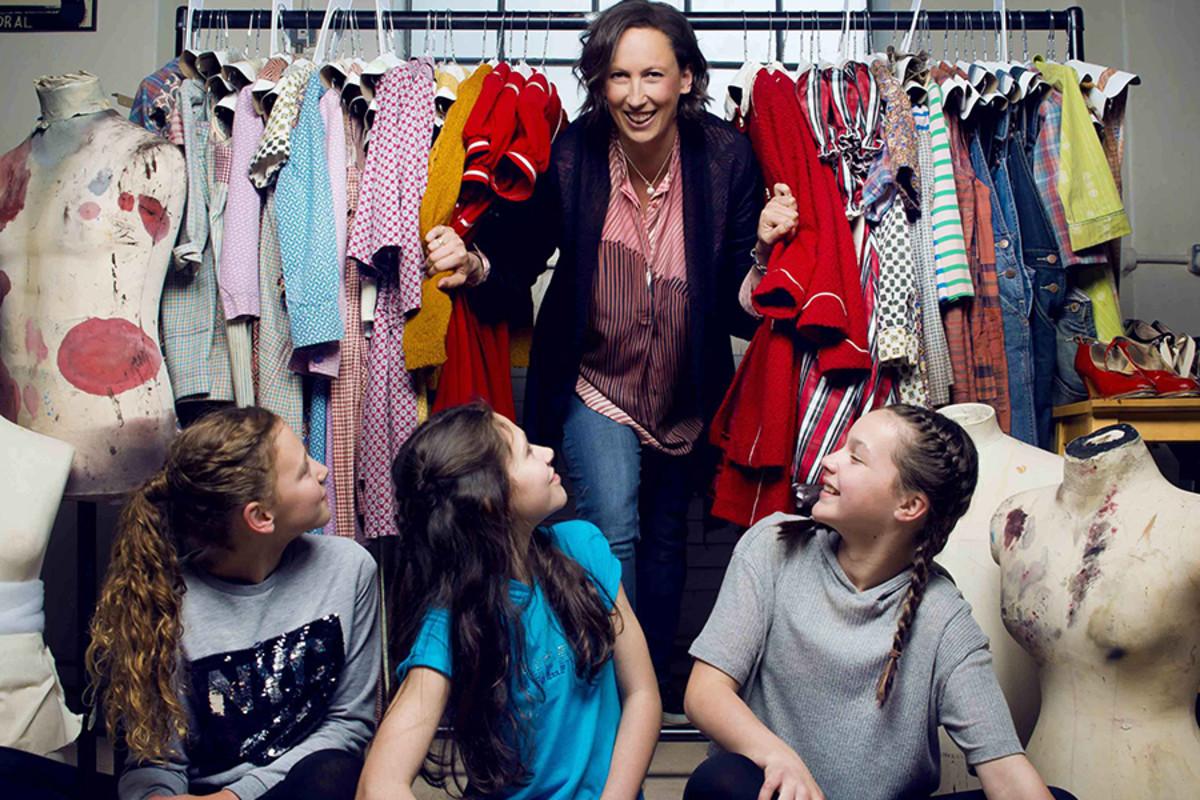 Lola Moxom, Ruby Stokes and Madeleine Haynes (alternating Annie), with Miranda Hart (Miss Hannigan) (Photo: Matt Crockett)