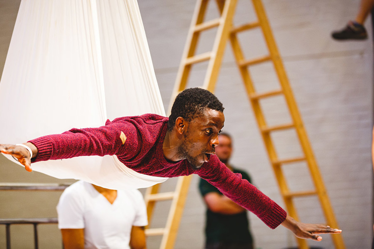 John Pfumojena (Michael) rehearses flying for Peter Pan (Photo Steve Tanner)