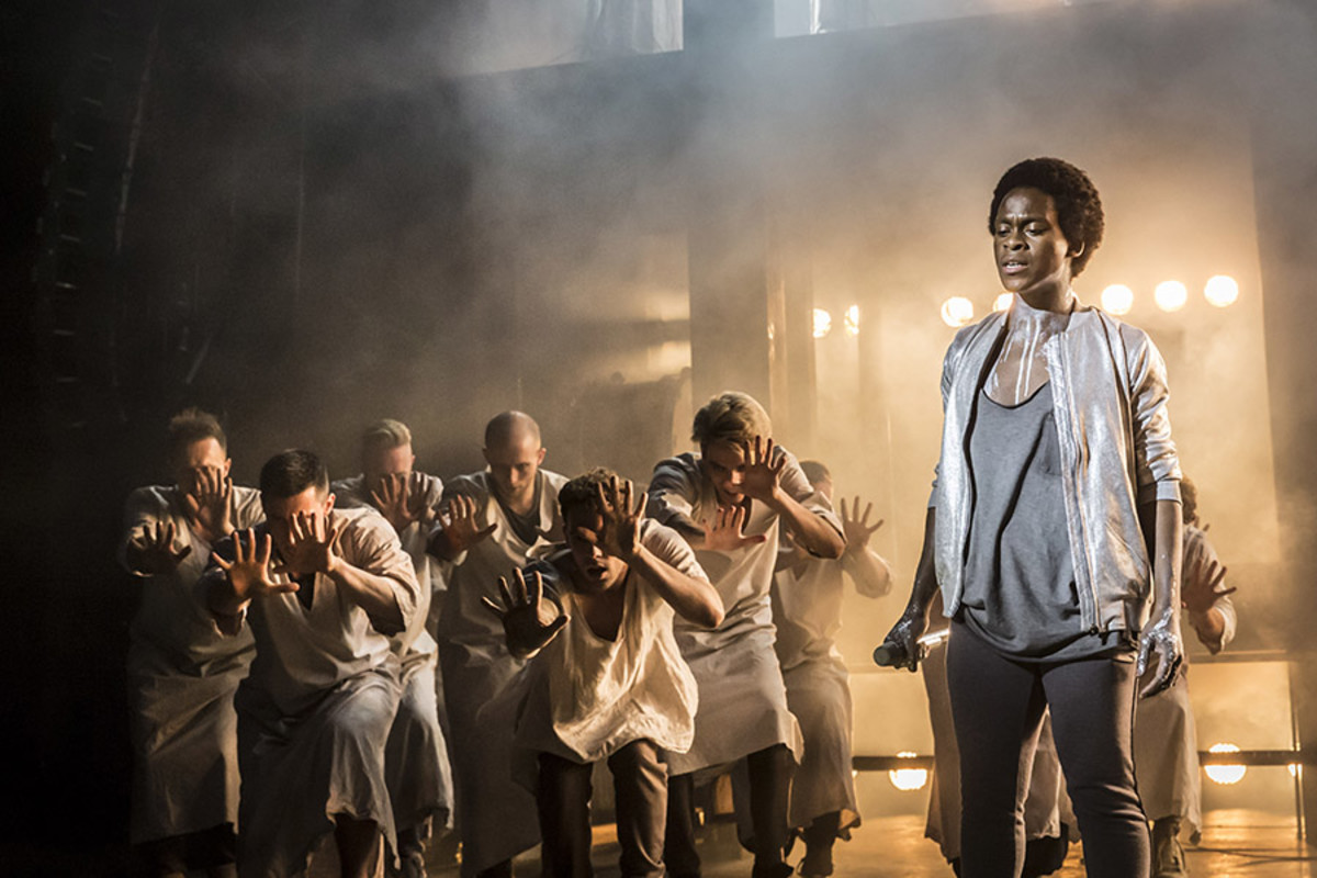 Tyrone Huntley as Judas and ensemble in Jesus Christ Superstar (Photo: Johan Persson)