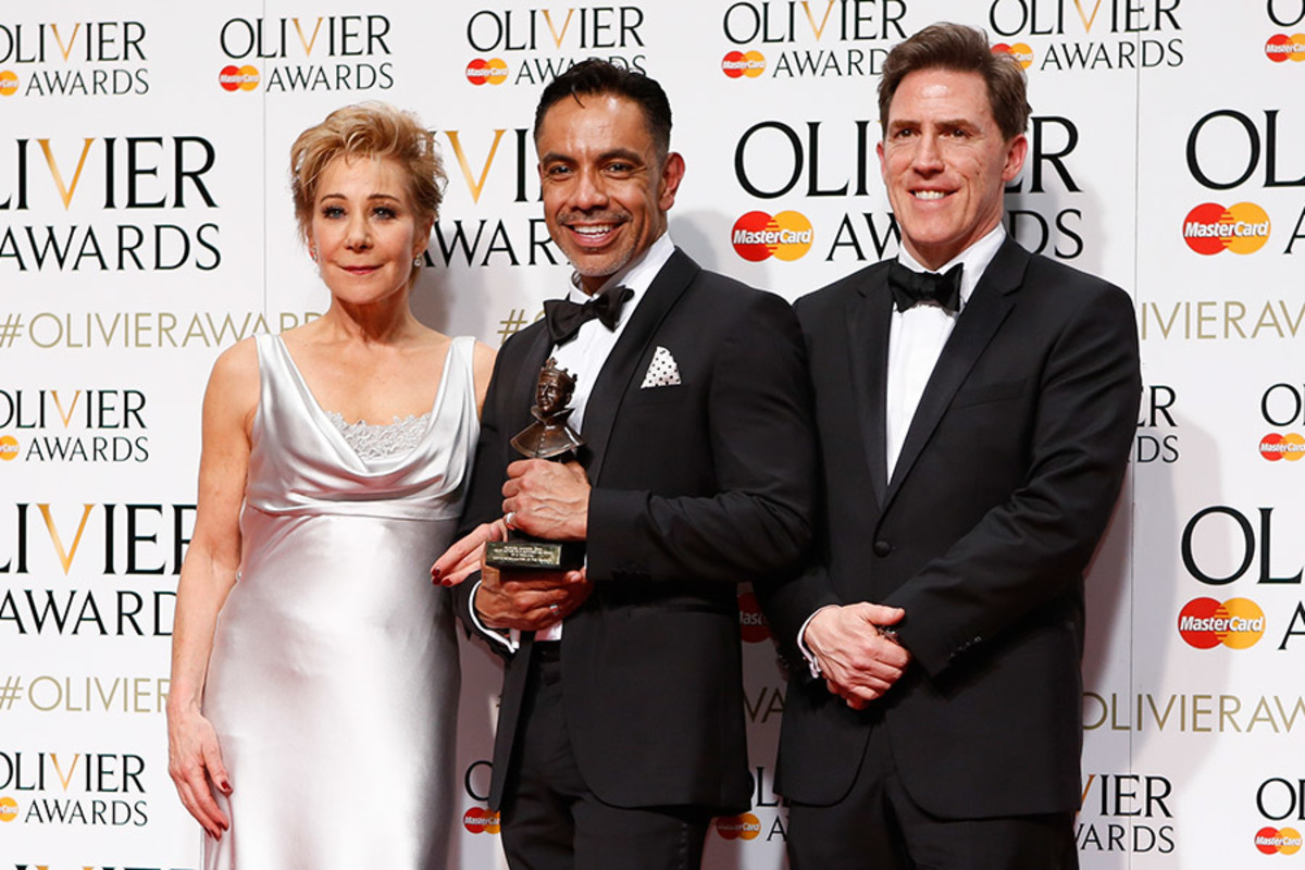 David Bedella, winner of the Olivier Award for Best Actor in a Supporting Role in a Musical for In The Heights, with presenters Zoë Wanamaker and Rob Brydon (Photo: Pamela Raith)