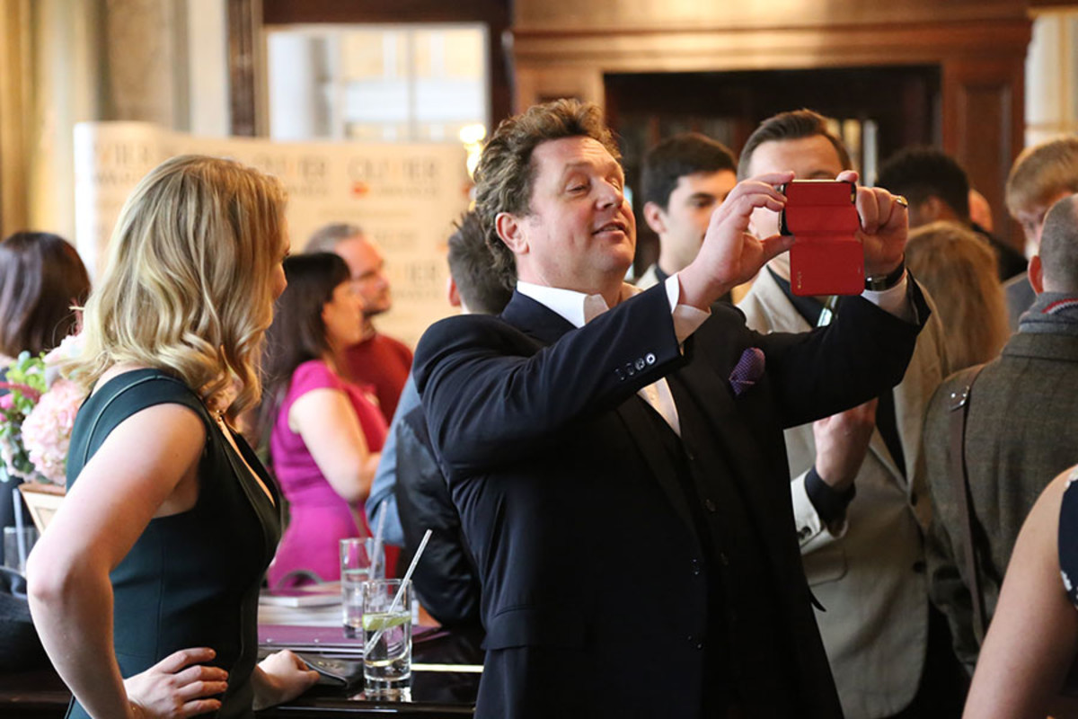 Host Michael Ball snaps a picture at the Olivier Awards 2016 with MasterCard nominees' celebration