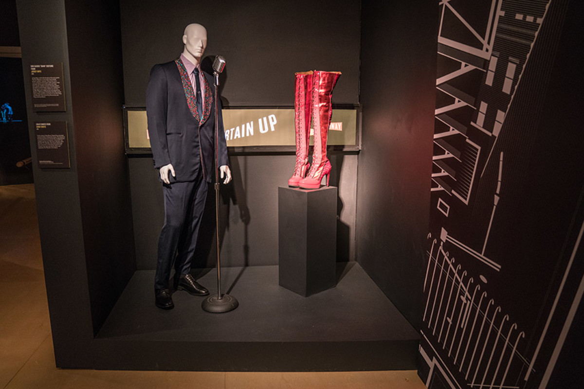 Install View of Bob Gaudio 'Dawn' Costume from Jersey Boys and Kinky Boots from Kinky Boots at the Curtain Up Exhibition (copyright Jonathan Blanc & New York Public Library)