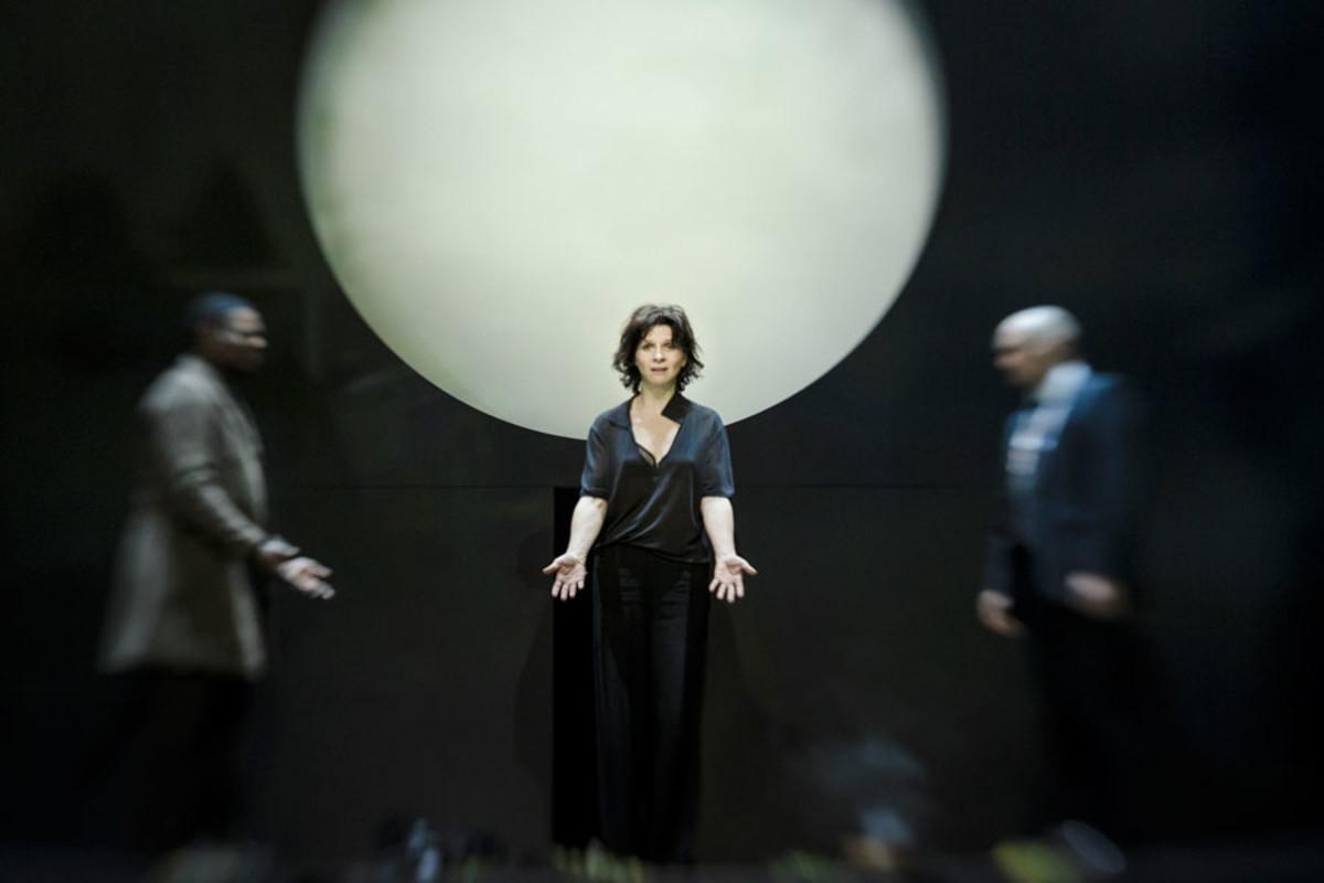 Obi Abili, Juliette Binoche and Patrick O'Kane appear in Ivo Van Hove's production of Antigone (Photo: Jan Versweyveld)