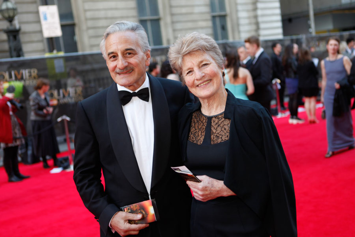 Best Actor nominee Henry Goodman walks the red carpet with his wife at the Olivier Awards 2014 with MasterCard (Photo: Pamela Raith)