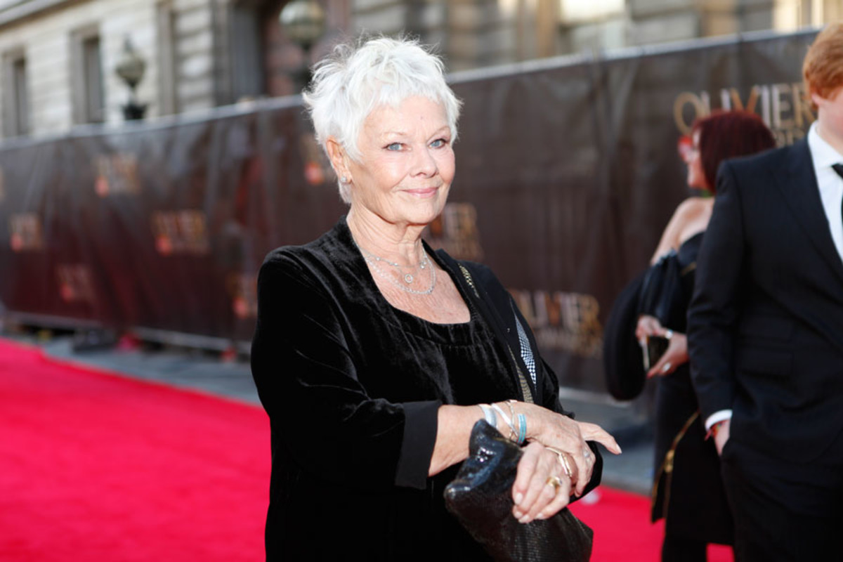 Best Actress nominee Judi Dench walks the red carpet at the Olivier Awards 2014 with MasterCard (Photo: Pamela Raith)