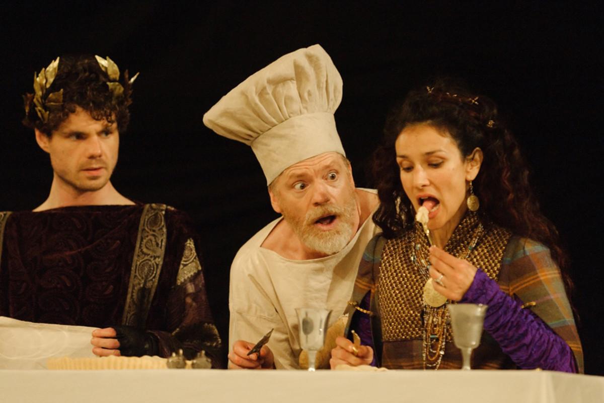Matthew Needham, William Houston and Indira Varma in Titus Andronicus at Shakespeare's Globe (Photo: Simon Kane)
