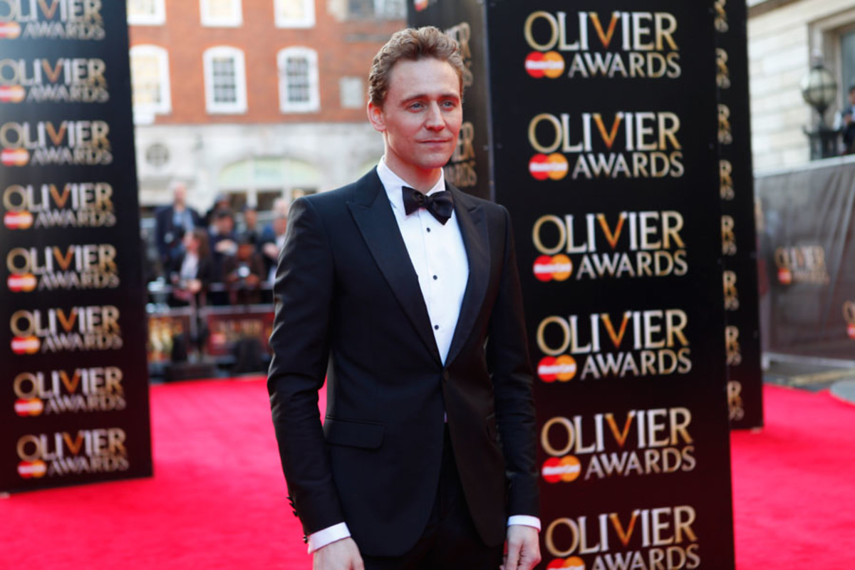 Best Actor nominee Tom Hiddleston walks the red carpet at the Olivier Awards 2014 with MasterCard (Photo: Pamela Raith)