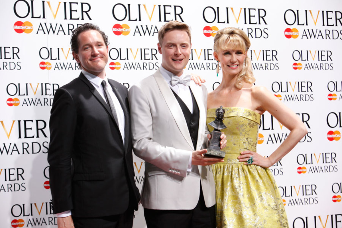 Stephen Ashfield, winner of Best Performance in a Supporting Role in a Musical, with presenters Bertie Carvel and Leigh Zimmerman (Photo: Pamela Raith)