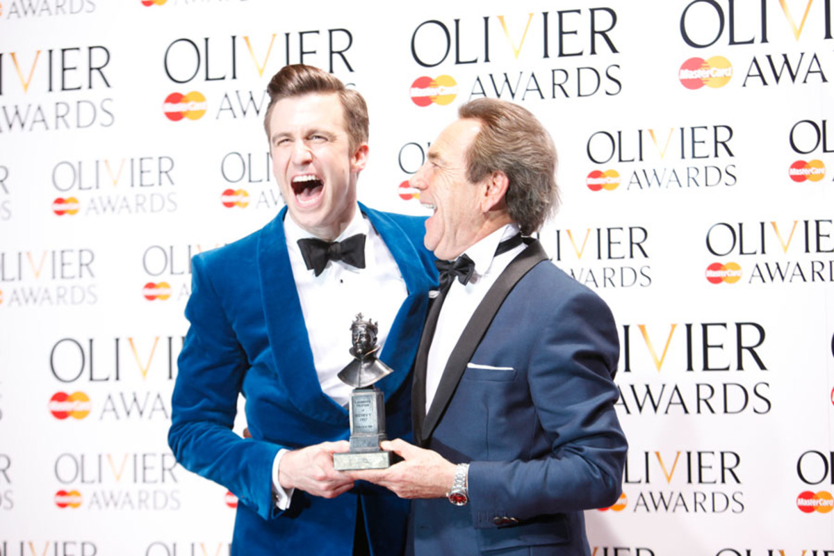 Gavin Creel, winner of Best Actor in a Musical, with presenter Robert Lindsay (Photo: Pamela Raith)