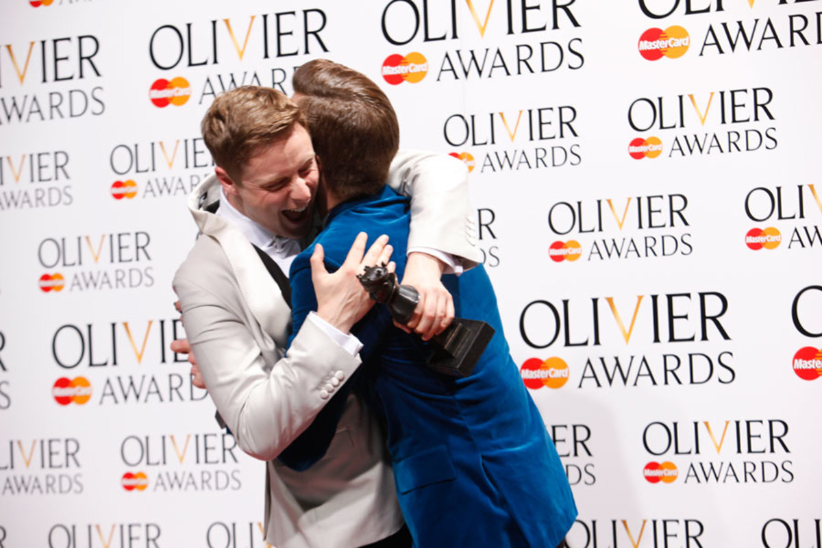 Stephen Ashfield and Gavin Creel congratulate each other on their Olivier Award wins (Photo: Pamela Raith)