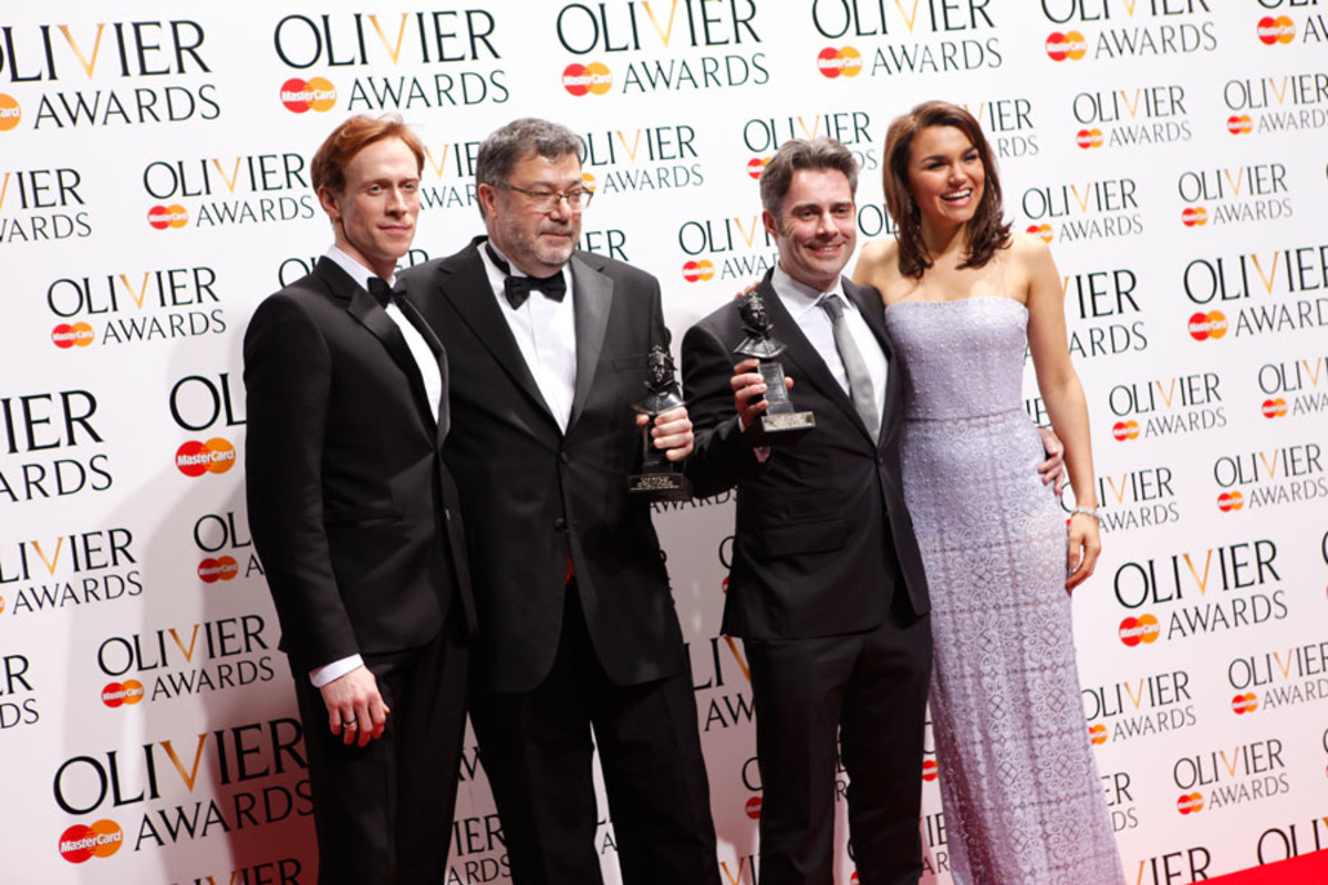 Paul Pyant and Jon Driscoll, winner of the Best Lighting Design Award for Charlie And The Chocolate Factory, with presenters Edward Watson and Samantha Barks (Photo: Pamela Raith)