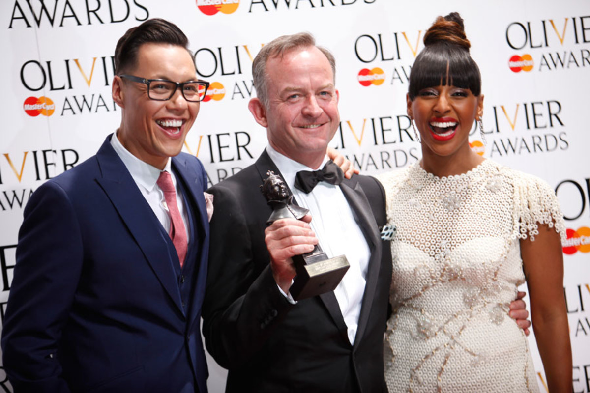 Mark Thompson, winner of the Best Costume Design Award for Charlie And The Chocolate Factory, with presenters Gok Wan and Alexandra Burke (Photo: Pamela Raith)