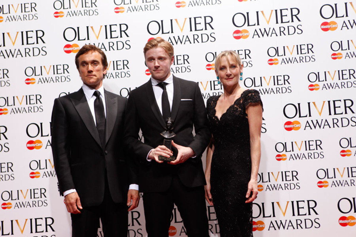Jack Lowden, winner of the Best Actor in a Supporting Role Award for Ghosts, with presenters Ben Miles and Lesley Sharp (Photo: Pamela Raith)