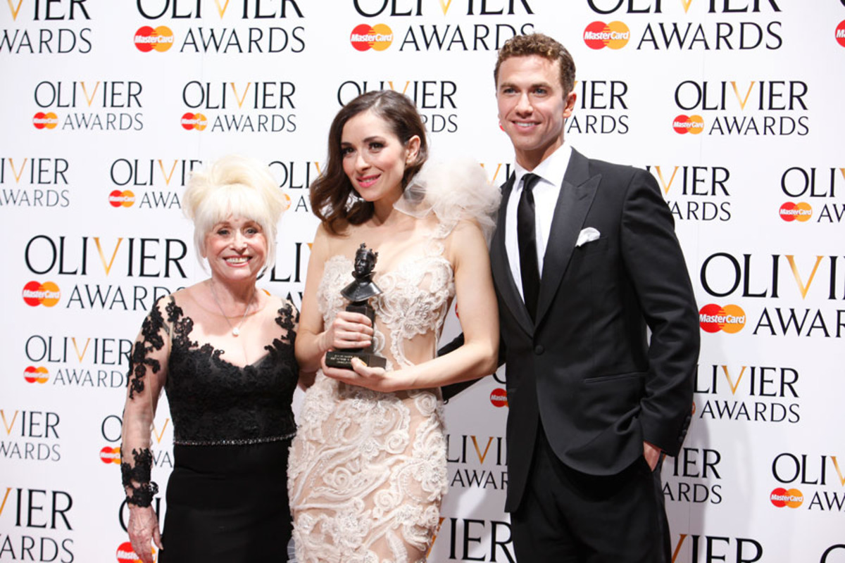 Zrinka Cvitešić, winner of the Best Actress in a Musical Award for Once, with presenters Barbara Windsor and Richard Fleeshman (Photo: Pamela Raith)